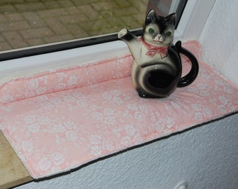 Cuddly cat cushions, window cushions,