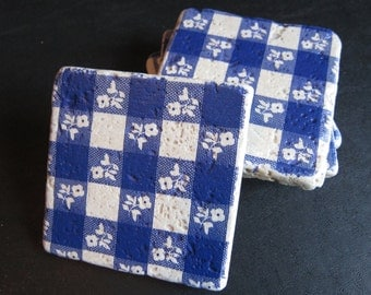 Set of 4 tumbled stone coasters with blue and white gingham fabric design. Also comes in red & white.