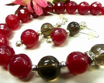Red jade set faceted smoky quartz