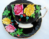 Aynsley hand painted enamel roses tea cup and saucer