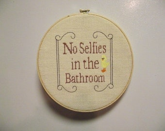 """Cross stitch embroidered """"No Selfies in the Bathroom"""" wall hanging"""
