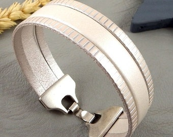 ivory leather striped metal silver and silver plated clasp strap
