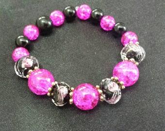 Hot pink and black glass beaded bracelet