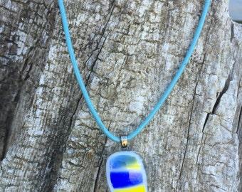 Fused glass pendant on turqoiuse leather cord necklace