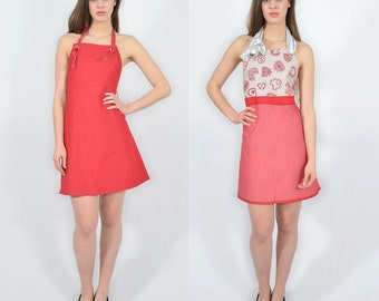 A two-sided red apron dress