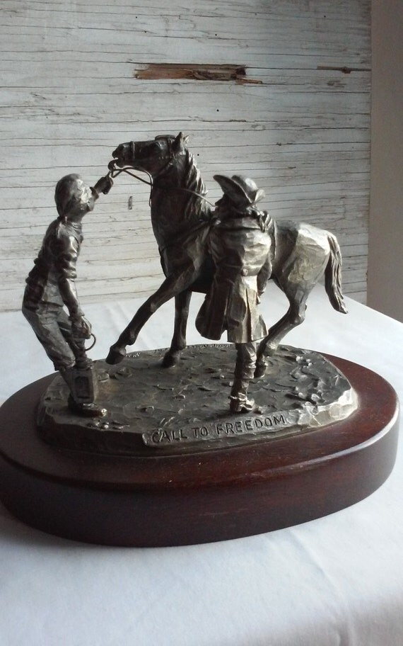 """Vintage 1972 Sculpture """" Call to Freedom """"by Artist Phillip Kraczkowski.  Nicely done.  On a nice wooden base.  Great Condition.  Historical"""