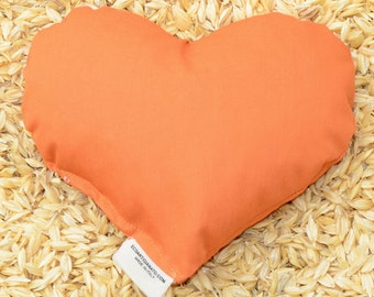 Heart-shaped wrist rest or heating pad With spelt chaff