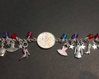 Fashion themed stainless steel charm bracelet