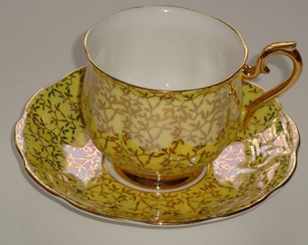 Royal Albert Glossy Yellow and Gold Tea Cup and Saucer