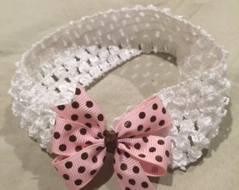 Brown and Pink Polka Dotted circle bow attached to white elastic headband