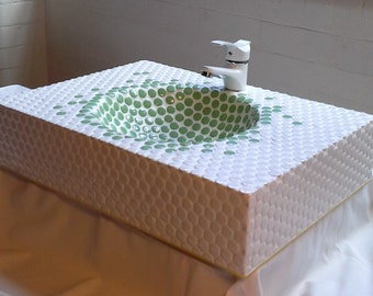 Bespoke wash basin with green and white penny tiles