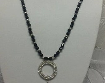 Black single strand with silver circle icicle pendant drop