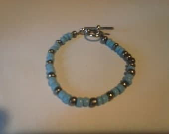 Toddlers small blue and silver beaded bracelet.