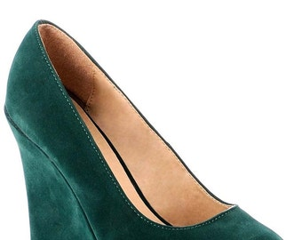 Green suede wedge style shoes