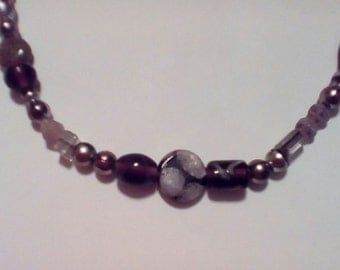 Plum colored long necklaces