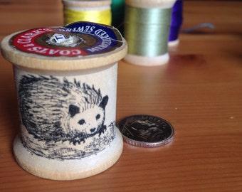Vintage thread spool with hand drawn hedgehog