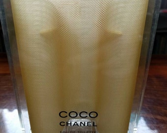 Coco Chanel plastic storage container for purse spray and refills