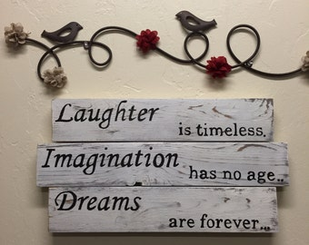 Laughter Is Timeless, Imagination Has No Age, Dreams Are Forever Distressed Wood Sign