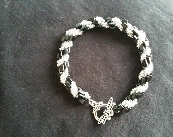 Black oblong bead and Silver Lined seedbead Spiral Bracelet with dragonfly clasp