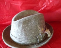 1990's Dobb's tweed hat, Derby Bowl style with feather in hat band; 75% wool; size 6 and 7/8