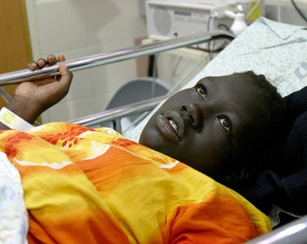 Sudanese refugee giving birth in Hospital