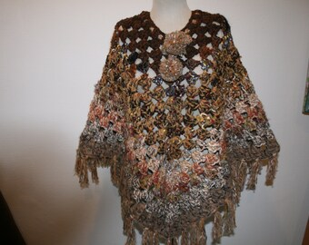Poncho cache shoulders in a single Brown declined