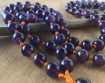 JAPA Mala of amethyst and orange tassel. Buddhist rosary. JAPA Mala stone