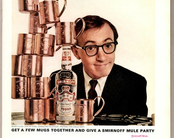 1960s Smirnoff Vodka with Woody Allen as spokesperson getting a few mugs together for a mule party Vintage magazine ad