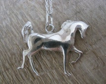 Pendant - small - stylized - Arabian horse in freedom - silver solid