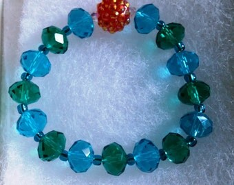 Lake Sunset Blue Green Faceted Glass Bead Stretch Bracelet with Orange Crystal Studded Bead