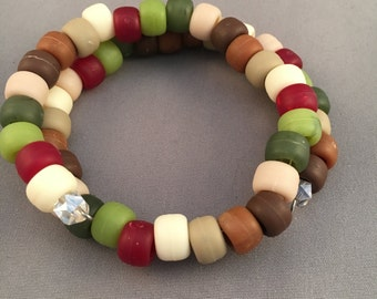 This memory bracelet has Toho beads of browns, creams, green, and dark red beads