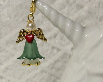 Mysterious forest fairy with heart in Pine Green, white, red and gold