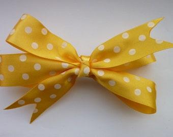 Yellow pinwheel bow with polka dots