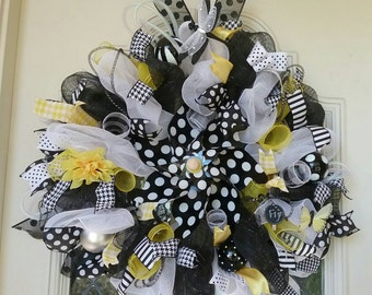 Deco mesh fun wreath for any time of the year in white, black and yellow. Large and will show well on door.