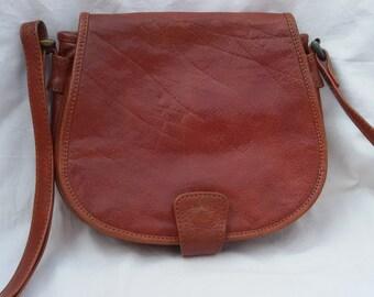 Vintage brown leather saddle bag / shoulder bag / flap bag