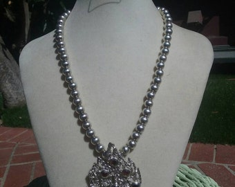 This absolutely amazing sterling silver necklace with sterling silver pendent and garnets.