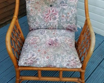 a lovely large wicker chair condition is good with removable cushion