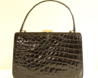 Black patent leather bag made in ca. 1960