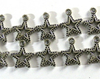 10 Tibetan silver star shaped charms, 15mm by 18mm