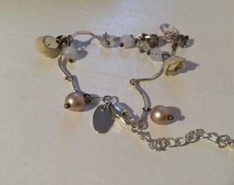 Ladies white metal fancy linked bracelet