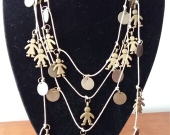 With gold coloured pendants