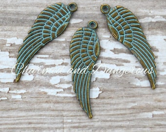 10 Antique Bronze Turquoise Patina Angel Wing charms (CM262)
