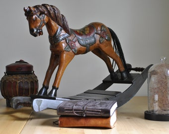 Small decorative wooden rocking horse