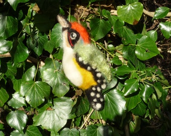 Needlefelted green woodpecker backed with green fleece.
