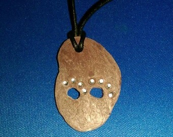 Pets paws with added sparkle on an adjustable leather necklace