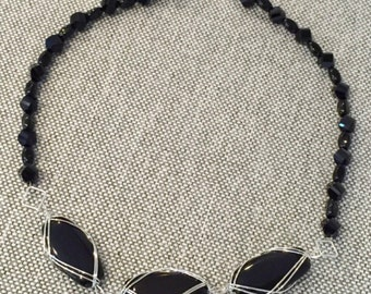 ATTRACTIONS LISTING Simple Elegance Black Necklace