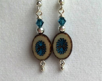 Oval glass bead earrings with turquoise flower center