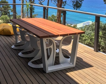 Blackbutt timber outdoor dining table featuring powder-coated trapezoidal legs 2250l x 1050w x 760h