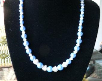 Blue  pearls.  Glass.
