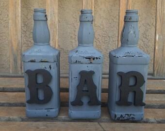 Decorated jack daniels bottles. Bar decor. Decorated bottles. Jack daniels decor